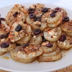 Печени картофи със сирене, риган и маслини