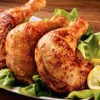 Печени пилешки бутчета с червен пипер, масло и лимон